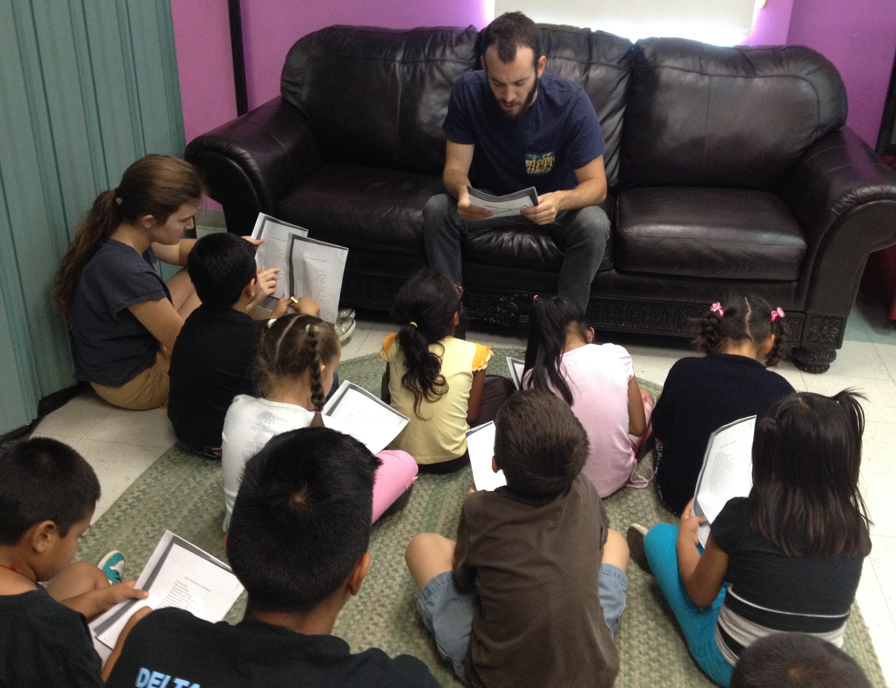 EdBoost Tutors Reading with Kids in the Children's Collective Summer Program